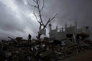 A Palestinian man walks through a neighbourhood destroyed during the 50-day conflict between the Israeli authorities and Hamas in Gaza. UN chief Ban Ki-moon said this week that promised aid would go towards the 'urgently needed' rebuilding of infrastructure and homes in Gaza where nearly 2,200 Palestinians were killed during the conflict
