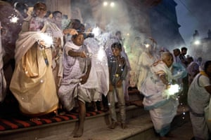 Indian women participate in a celebration for the Hindu festival Diwali in Vrindavan. The women are widows who have left or been abandoned by their families. Until recently, they were kept hidden from society but that is now changing, and local residents cheered as they walked by, many wearing new saris gifted by a local organisation