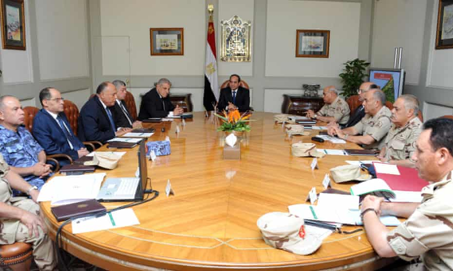 The Egyptian president, Abdel Fattah al-Sisi (centre), chairs a meeting with the National Defence Council.