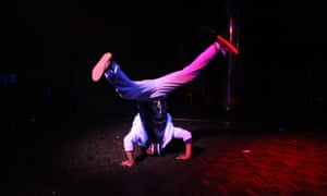 A young boy performs a headstand at Aleppo's daytime disco.