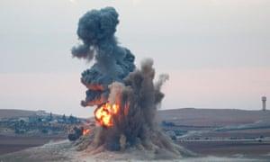 Smoke and flames rise near Syrian town of Kobani
