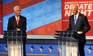 Charlie Crist, left, and Rick Scott wait to start a debate
