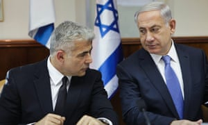 Israel's finance minister Yair Lapid, left, and prime minister Benjamin Netanyahu attend a cabinet meeting in Jerusalem.