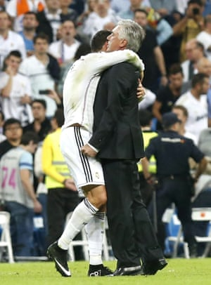 The final whistle goes and Real Madrid coach Carlo Ancelotti gets a hug from his captain Cristiano Ronaldo.