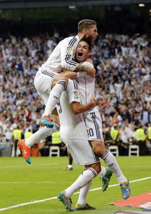 Karim Benzema is mobbed by Sergio Ramos, left, and James Rodriguez