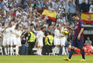 Lionel Messi cuts a disconsolate figure as he returns the ball to the centre circle as the Real Madrid players celebrate