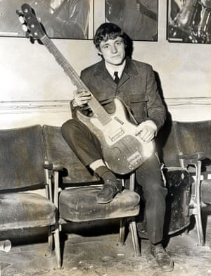 A young Jack Bruce with a bass guitar