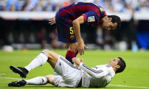 Barcelona's Sergio Busquets makes his feelings known to Cristiano Ronaldo after the pair clash