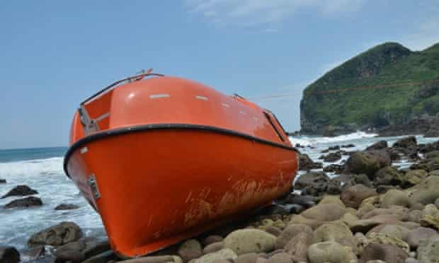 An orange disposable lifeboat that washed up on central Java's Karangjambe beach in February. The lifeboat is part of the federal government's boat turnback policy.