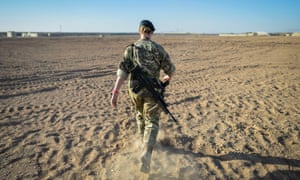 A British officer walks on deserted ground inside Camp Bastion on the exact spot where the very first tents were erected in 2006.