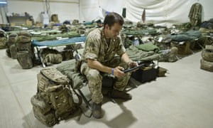 Staff Sergent Craig Worsley, 34, of 1st The Queen's Dragoon Guards, sitting inside temporary tented accommodation at Camp Bastion as troops prepare to withdraw and return to the UK.