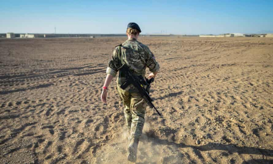 A British officer walking on deserted ground inside Camp Bastion, Helmand province, Afghanistan, on the exact spot where the very first tents were erected in 2006.