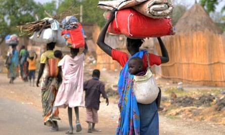 Displaced South Sudan women walk towards the UN base in Malakal in January.