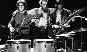 Bruce, left, with Ginger Baker, centre, and Eric Clapton at their farewell performance at the Royal Albert Hall, London, in November 1968.