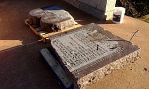 The damaged remains of a Ten Commandments monument are gathered on the Oklahoma State Capitol grounds.
