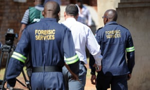 South African forensic investigators enter the home of actress and singer Kelly Khumalo in Vosloorus, east of Johannesburg
