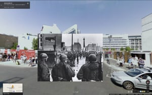 Friedrichstrasse crossing point December 4, 1961. American soldiers watch as construction workers, heavily guarded by East German security forces, build a massive stone barricade at the Friedrichstrasse crossing point in East Berlin