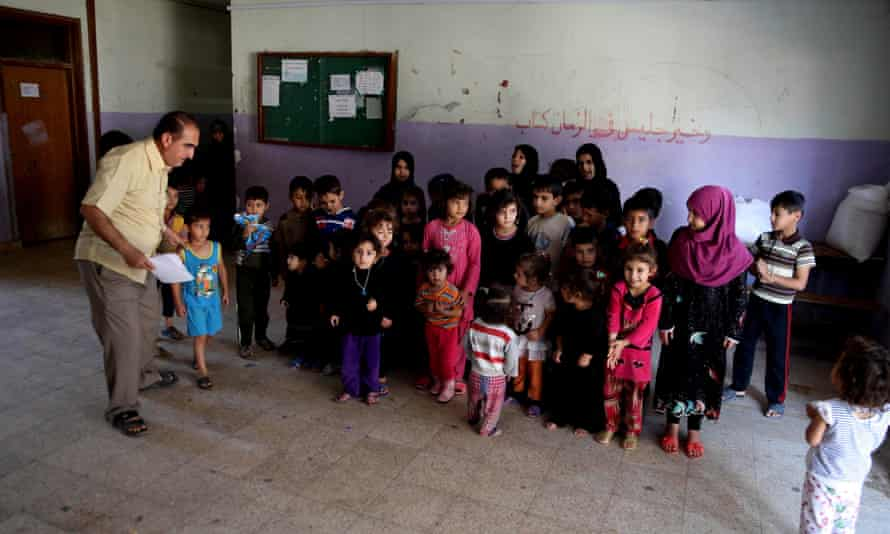 Iraqis who fled Mosul and other towns take shelter in Sadr City, Baghdad.