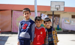 Iraqi boys at a school being used to shelter families who fled from Mosul.