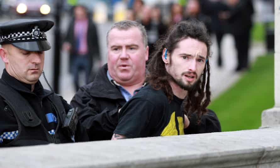 A man being arrested after apparently barging into David Cameron outside Leeds civic hall. He was later released and police said he did nothing wrong.