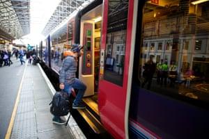 Passengers board the train at Huddersfield