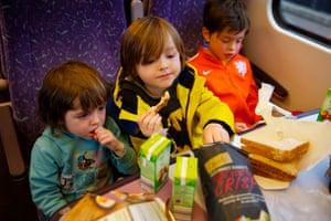 Children enjoy their lunch on the journey