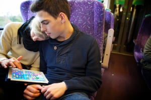A couple play a game on their tablet