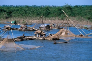 Traditional fishing methods at Kompong Cham on the Mekong river.
