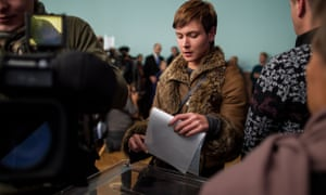 A young Ukrainian woman casts her ballot in Kiev, 26 October 2014