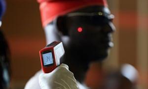 Man's temperature taken in Nigeria for Ebola screening