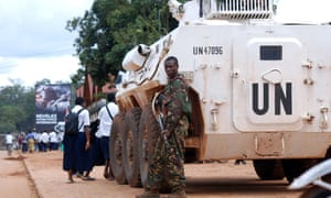 A soldier beside a UN armoured vehicle in Beni, Democratic Republic of Congo.
