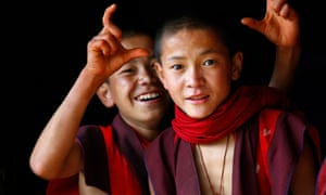 Monks posing at a school near the Bhutanese town of Paro. Bhutan measures prosperity by gauging its citizens' happiness levels.