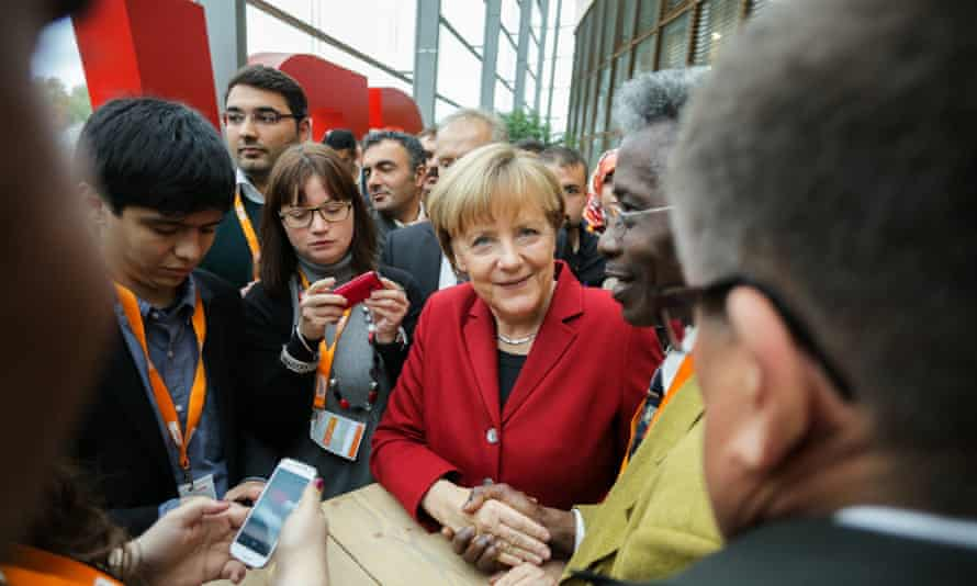 Chancellor Angela Merkel signed autographs in the crowd during a Integration Conference at the CDU-Party central on October 22, 2014 in Berlin.