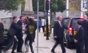 A still image taken from video shows a man appro0aching David Cameron in Leeds