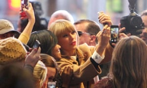 Taylor Swift meets fans before filming an episode of 'Good Morning America'.