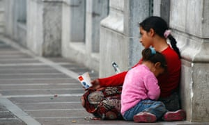 A woman begs with her child in Athens, Greece. The child poverty rate in Greece has jumped from 23% to 40.5%.
