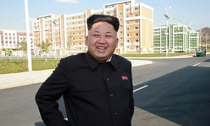 North Korean leader Kim Jong-un smiling as he inspects a newly-built housing complex in Pyongyang.