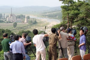 Foreign TV crews prepare to shoot the demolition of the Yongbyon nuclear complex's cooling tower, in June 2008.