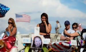 Cynthia Davis gets emotional as she visits the roadside memorial set up for victims of the Colorado theater shooting massacre in Aurora, Colorado.