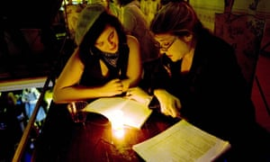 A poetry reading between two women at the Poetry Brothel in New York.
