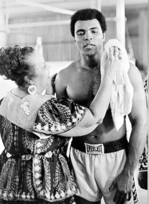 Muhammad Ali with his mother taking care of him during a training session
