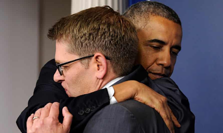 Jay Carney and Barack Obama hug