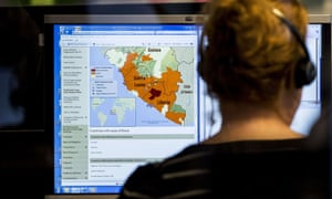 A woman looks at a map at the Dutch National Institute for Public Health and the Environment (RIVM) nationwide telephone information center in The Hague on October 20, 2014 set up for people who have questions about the virus of Ebola.