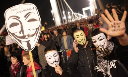 Protesters don masks during demonstrations against the proposed internet tax.