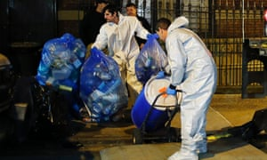 A biohazard crew clean the apartment of Dr Craig Spencer in New York City last week.