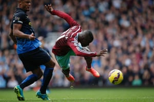 Enner Valencia of West Ham United is fouled by Manchester City's Vincent Kompany during the Premier League match at Upton Park in London.