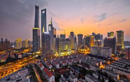 The Shanghai Tower (tallest building, left) under construction.