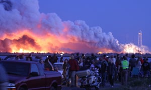 People who came to watch the launch walk away after the explosion in Virginia.