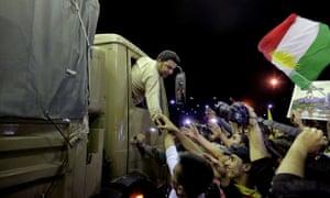 People cheer Iraqi Kurdish peshmerga troops on their way to Kobani