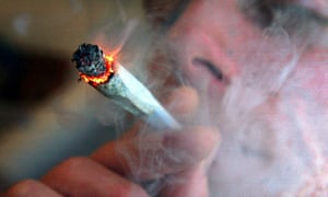 A file photo of an unidentified man smoking cannabis